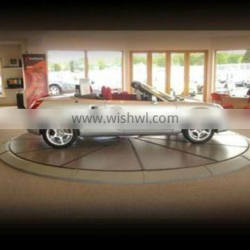 Automatic rotating driveway car turntable