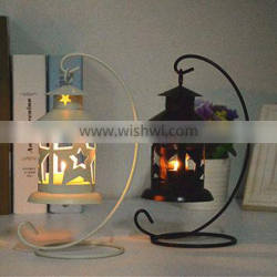 Black and white star shaped metal candlestick candle holder