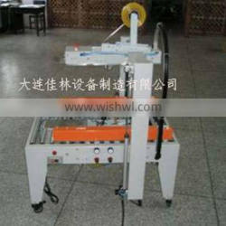 flaps folding carton sealer for motorcycle electrical system