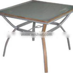white plastic outdoor table and chair in glass table top with teak wood