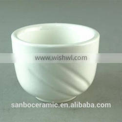 white porcelain cup with embossed wave design
