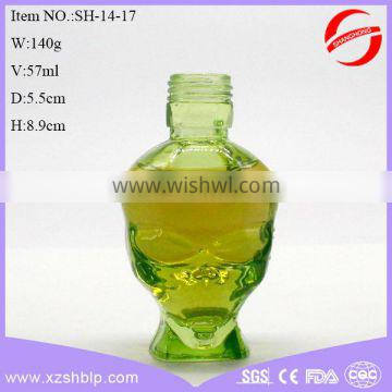 green skull shape glass bottle for perfume