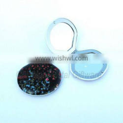 Elegant compact mirror with flowers printed on the top