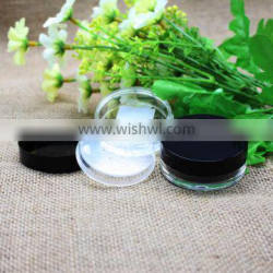 Empty black loose powder jar with sifter cosmetic use