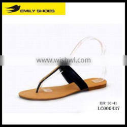 Lady's T-strap slipper with plastic accessory