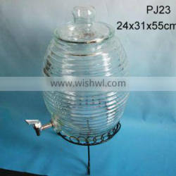 large clear drum shaped glass jar with glass lid and tap
