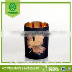 Machine made black colored maple shape candle cups