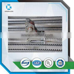 Greenhouse sun shade rack and pinion system