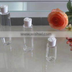 transparant cosmetic lotion bottle with white rose cap
