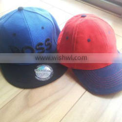 red baseball cap with white embroidery logo