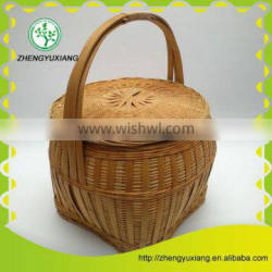 Antique handwoven bamboo picnic basket