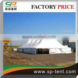 Century High Peak tents 18x30m staked to dirt land by stakes with windows sidewalls
