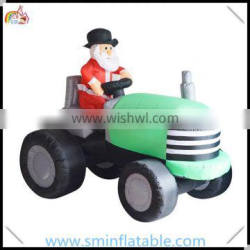Commercial inflatable santa tractor, inflatable santa claus driving truck for christmas decor from china manufacturer