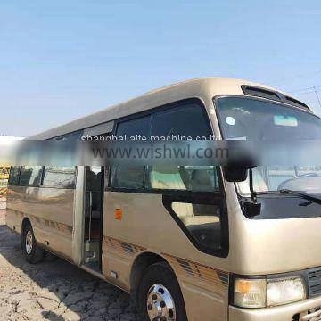 petrol / diesel manual used cheap JAPAN MADE white toyota coaster for sale with 30 seats