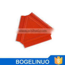 Rubber Comb with Graduated Teeth for Creating Combing Effects in Paint and Plaster