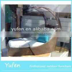 Outdoor rattan sun lounger with shade