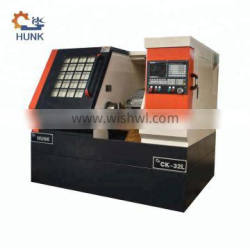 Full Cover Form of Small Cnc Lathe Machine with Bar Feeder