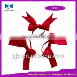 red small ribbon bow with elastic cord