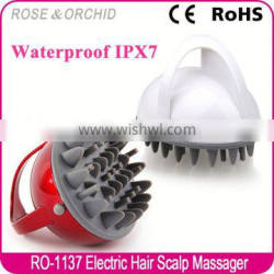 Hand held hand-held head massager for hair washing